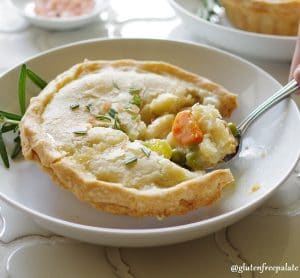 A delicious Gluten-Free Chicken Pot Pie made from scratch using chicken, carrots, onion, peas and a creamy and smooth gravy like sauce.