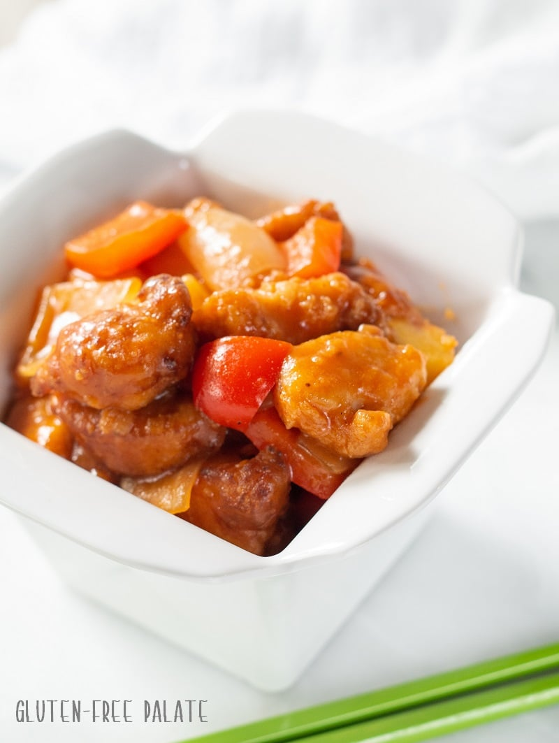 side view of Gluten Free Sweet and Sour Chicken in a white dish