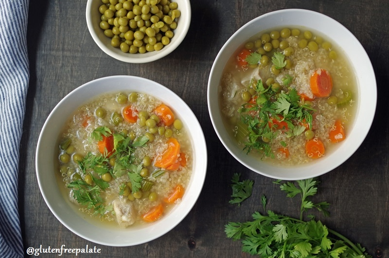 two bowls of quinoa soup with vegetables and chicken next to a bowl of peas
