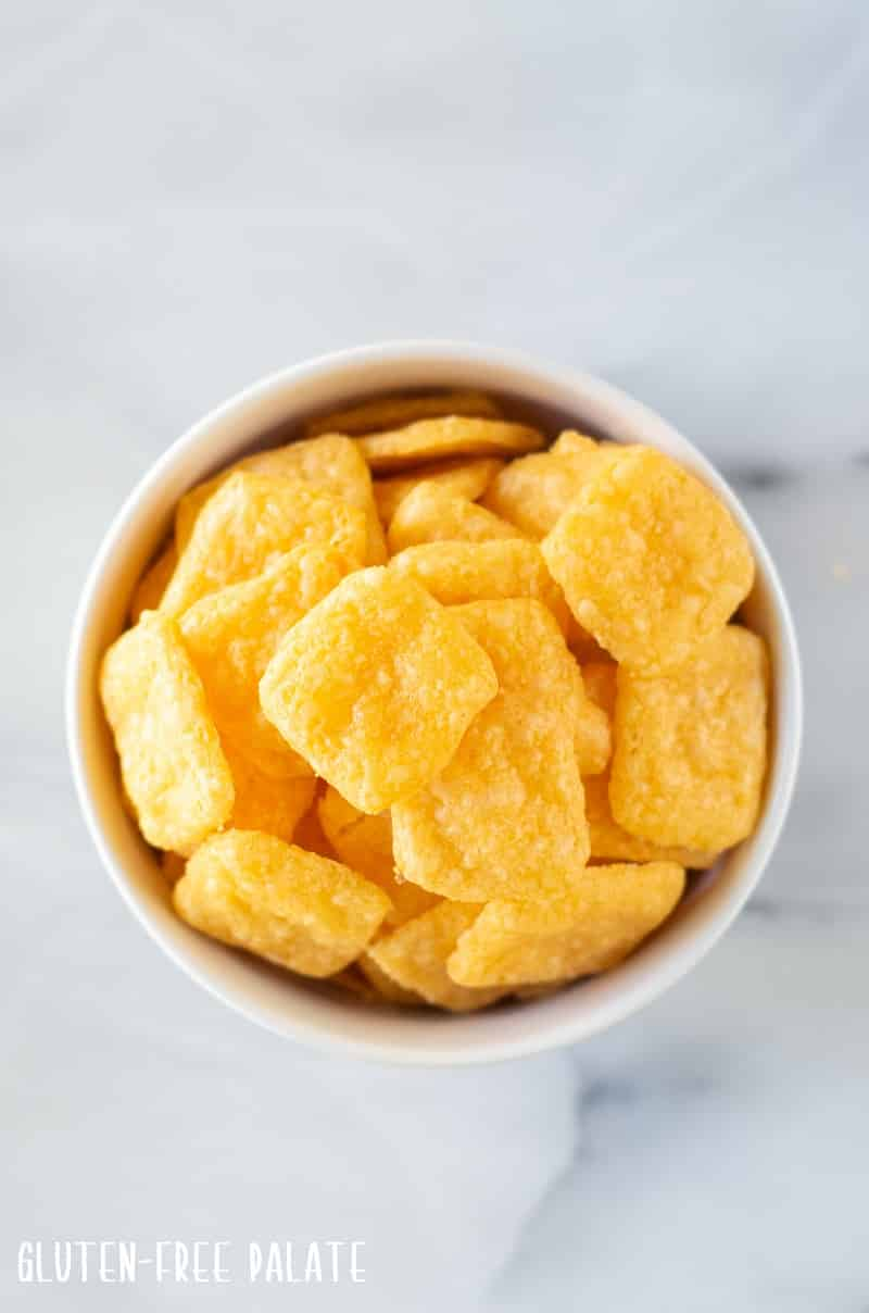 top down view of gluten free cheese crackers in a white bowl