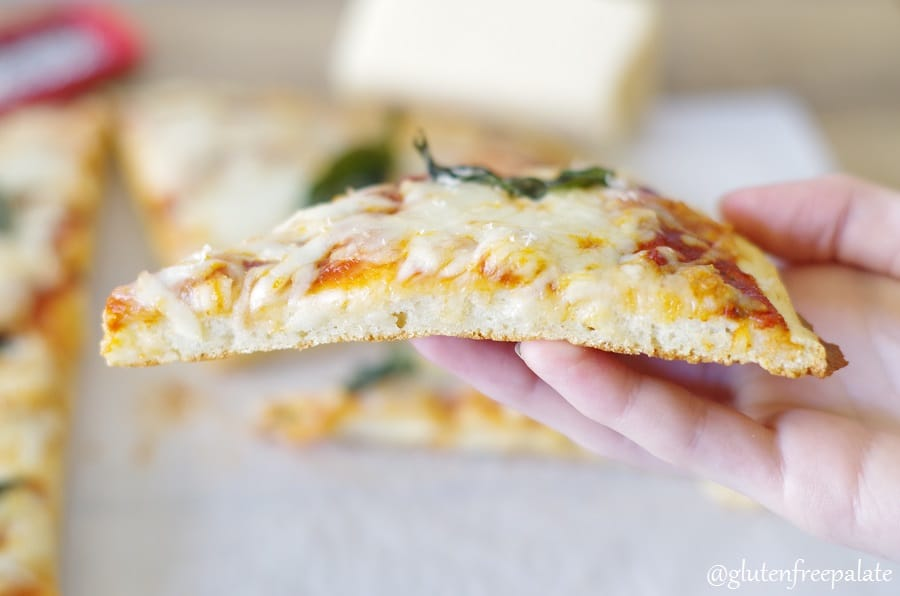 My go-to Gluten-Free Pizza Crust recipe is a simple staple for your Gluten-Free kitchen. Perfectly thick and chewy, and no kneading required.