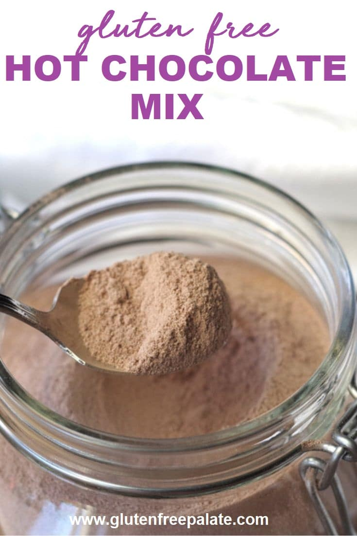 pinterest pin of a spoon of homemade hot chocolate mix over a glass jar with the words gluten free hot chocolate mix on top