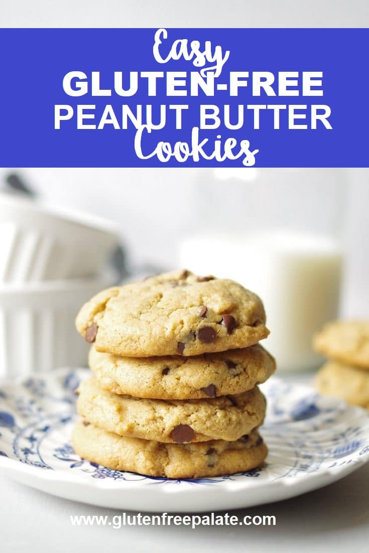Stacked gluten-free peanut butter cookies on a plate.
