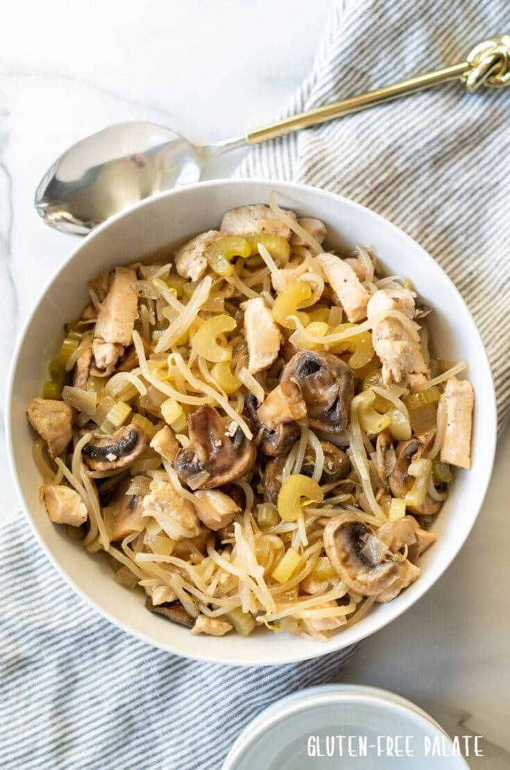 a close up of chicken subgum chow mein in a white bowl