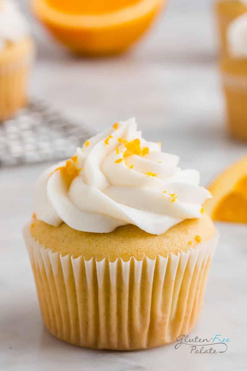 close up of a gluten free orange cupcake