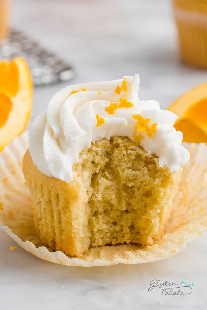 gluten free orange cupcake with a bite out of it