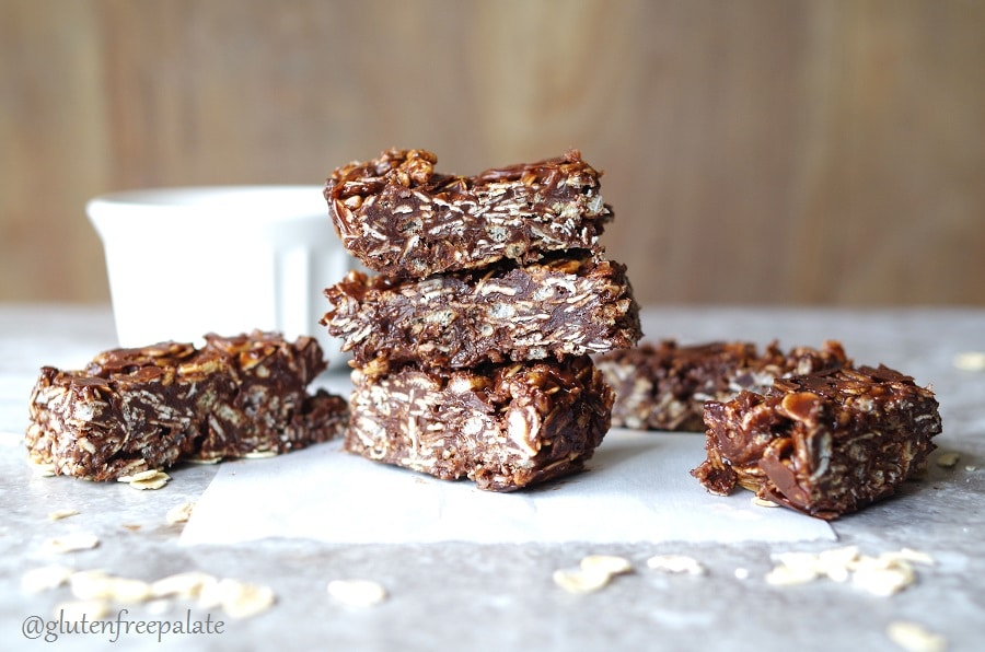 Chocolate coconut oat bars stacked.