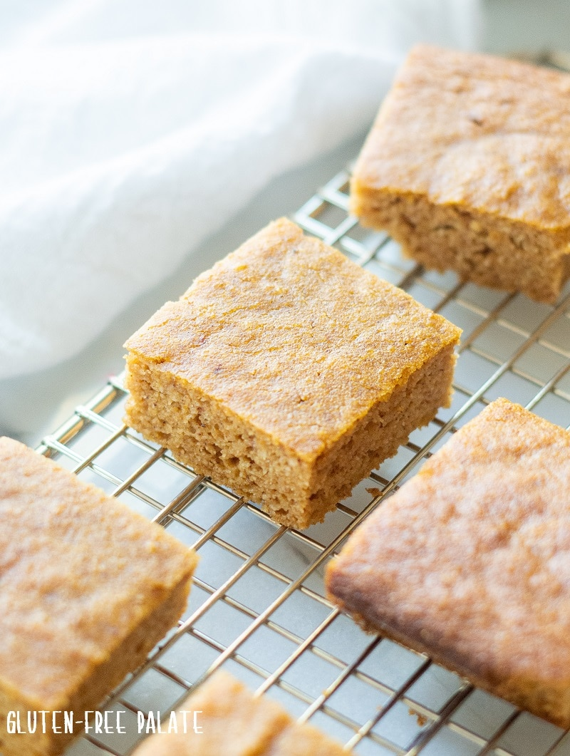paleo pumpkin bars cut in squares on a wire rack