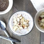 top down view of overnight paleo porridge in a class bowl with sliced almonds.