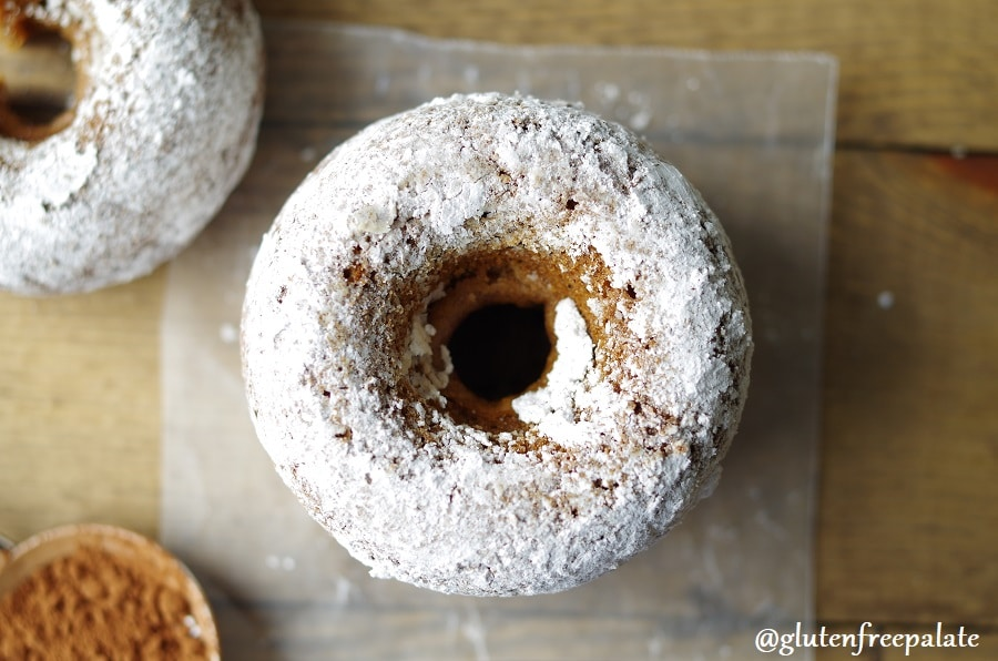 a top down view of a gingerbread donut coated in powdered sugar