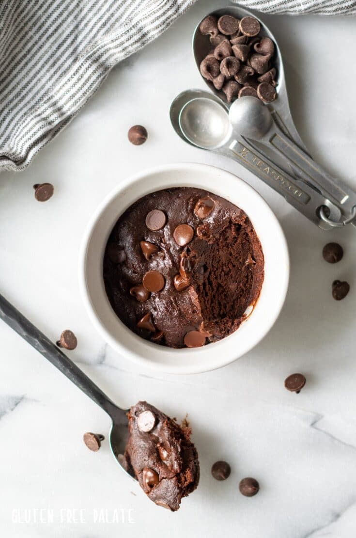 mug cookie in a white ramekin with a bite out