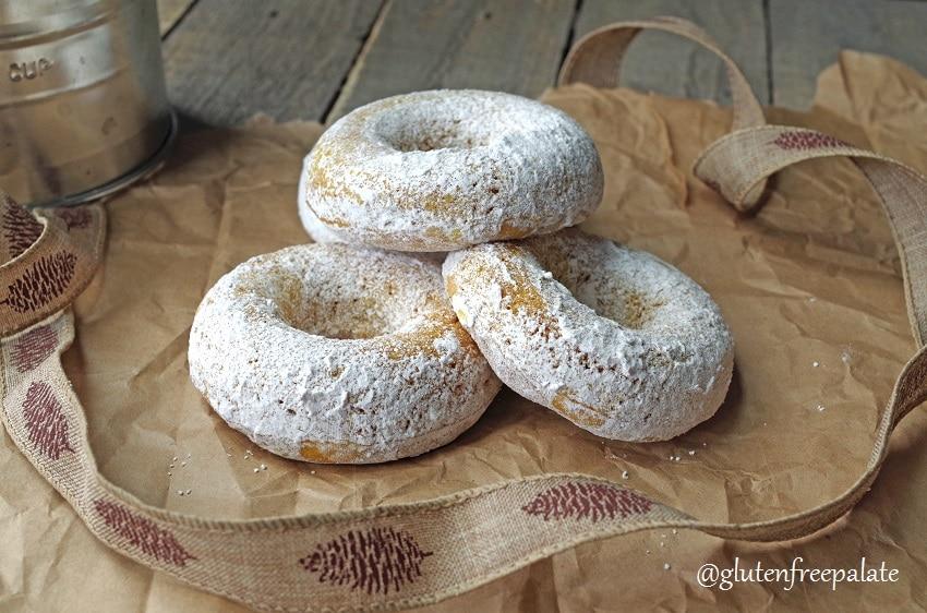 gluten free pumpkin donuts stacked.