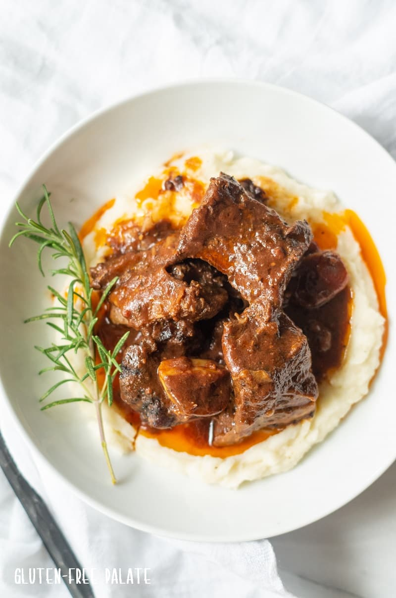 top down view of beef short ribs over mashed potatoes