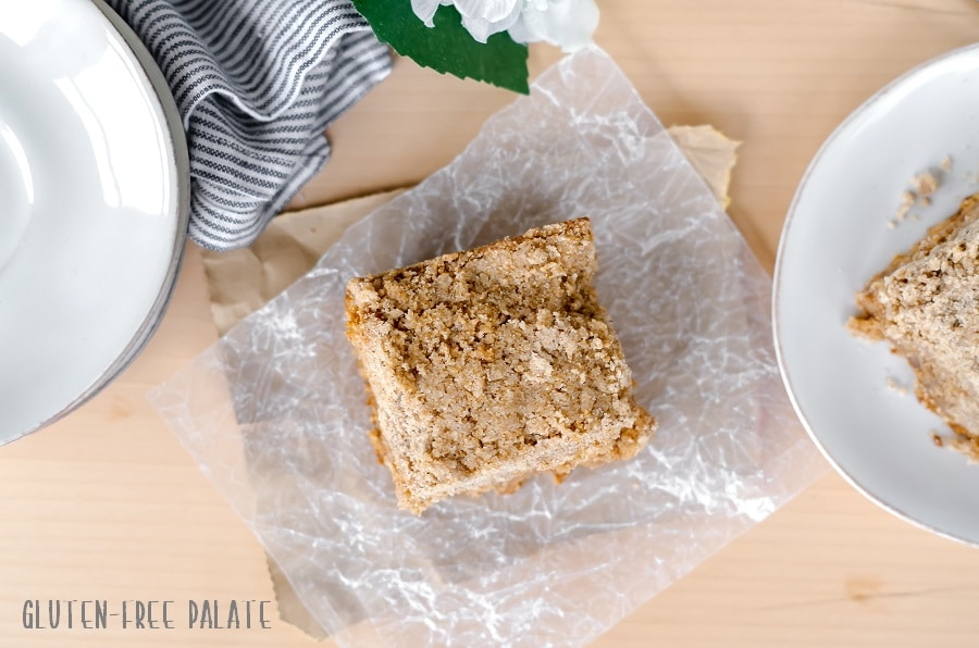 top down view of a slice of gluten-free chai coffee cake on a piece of parchment paper
