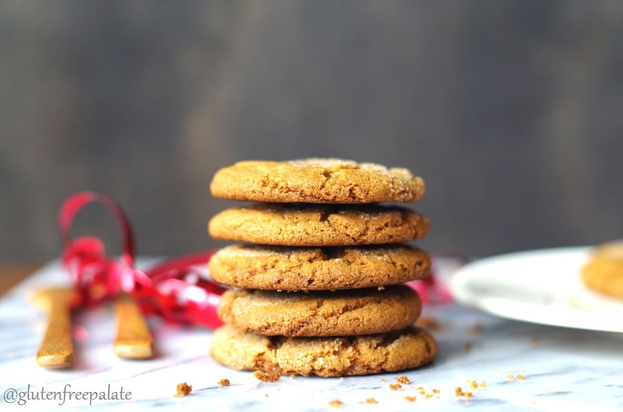 Gluten Free ginger snap cookies stacked on a plate.