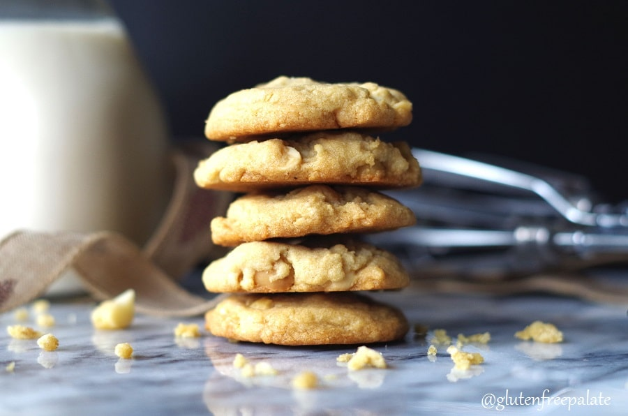 five gluten free white chocolate macadamia cookies stacked