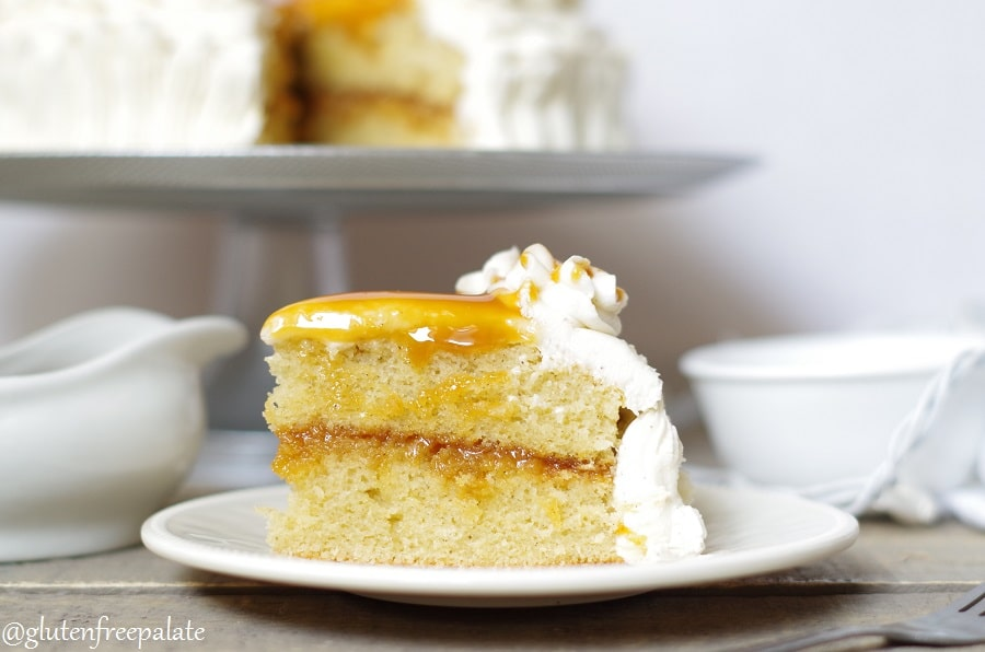 gluten free caramel cake topped with frosting and caramel.