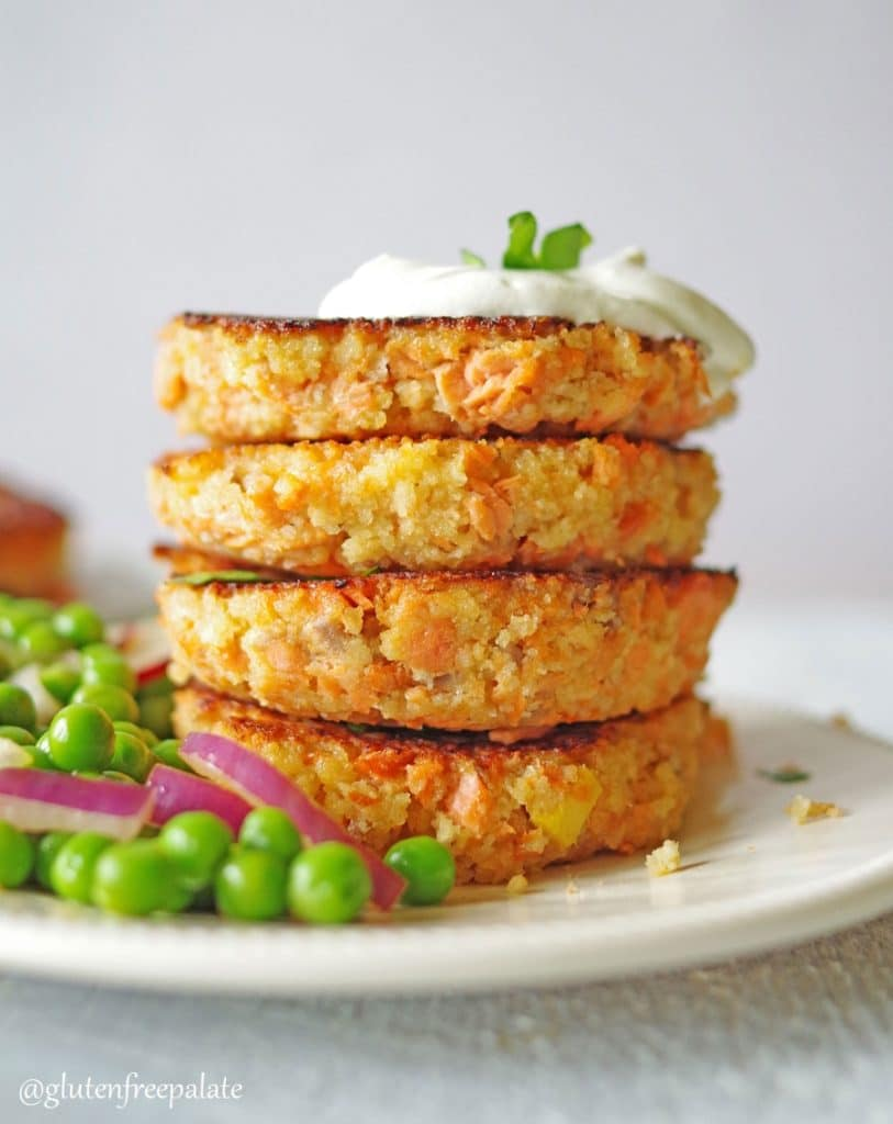 Gluten-Free Salmon Cakes on a white plate with garnish.
