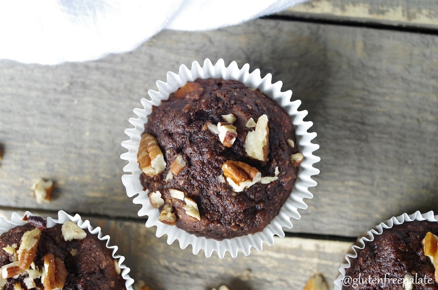 top down view of a chocolate banana muffin topped with chopped nuts