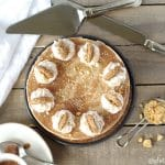 Cinnamon roll cake, topped with creamy Snickerdoodle non-dairy frozen dessert, whipped cream, snickerdoodle cookies and a cinnamon glaze make this Gluten-Free Vegan Cinnamon Roll Ice Cream Cake and unique and scrumptious frozen treat.