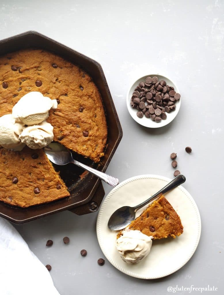 Break out the cast iron skillet because I've got a Gluten-Free Pumpkin Chocolate Chip Skillet Cookie recipe that you're going to love. This recipe has all the delicious qualities of a chocolate chip cookie mixed with smooth pumpkin, and fragrant spices.