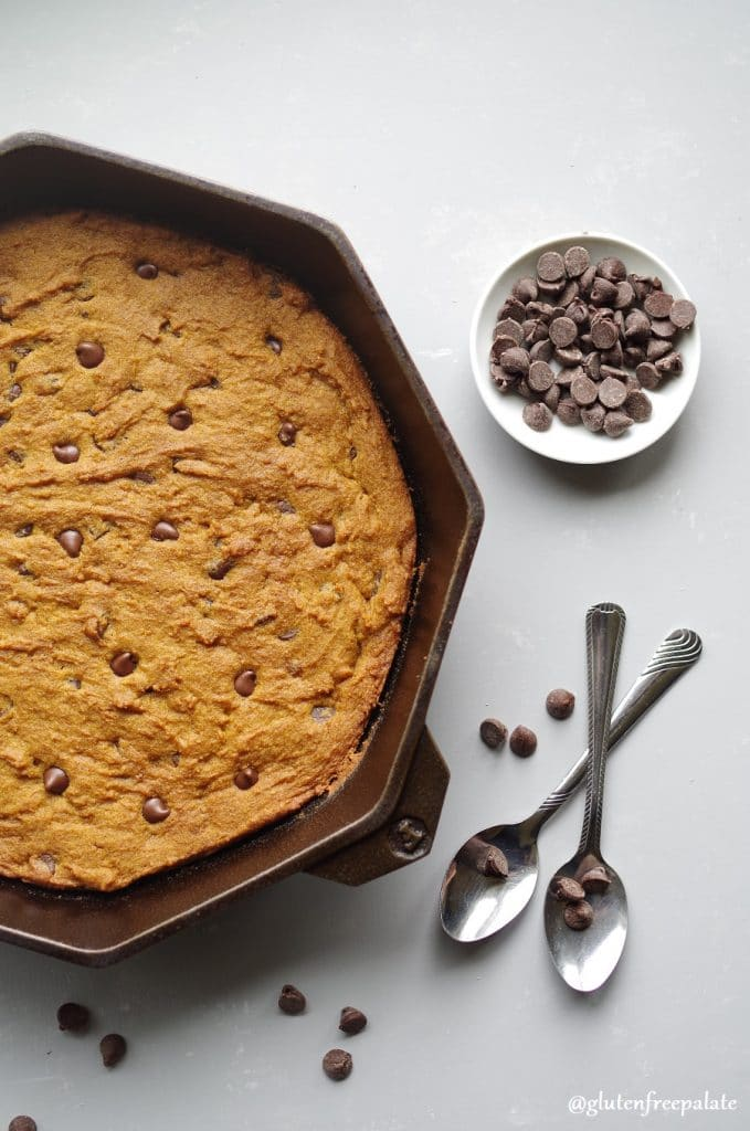 gluten free pumpkin chocolate chip skillet cookie in a cast iron skillet.