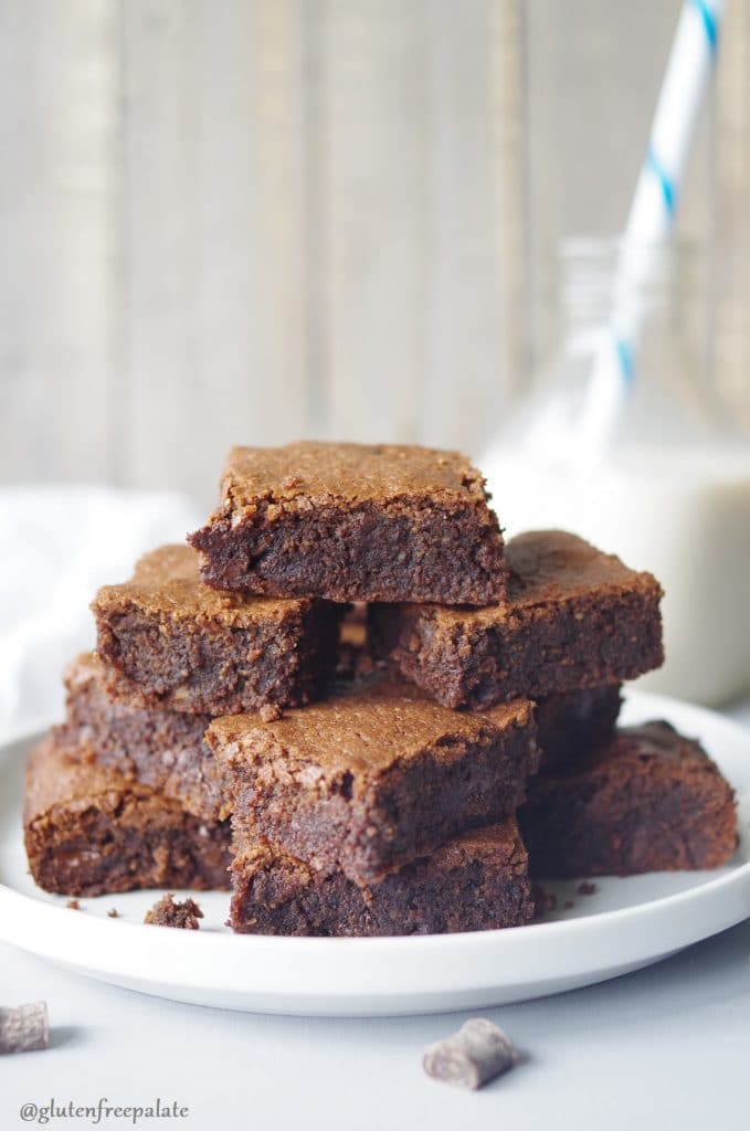 Grain-Free Hazelnut Brownies stacked on a white plate