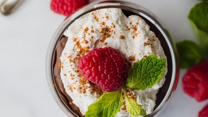 top view of a Gluten-Free Vegan Mexican Chocolate Pudding topped with mint and raspberry
