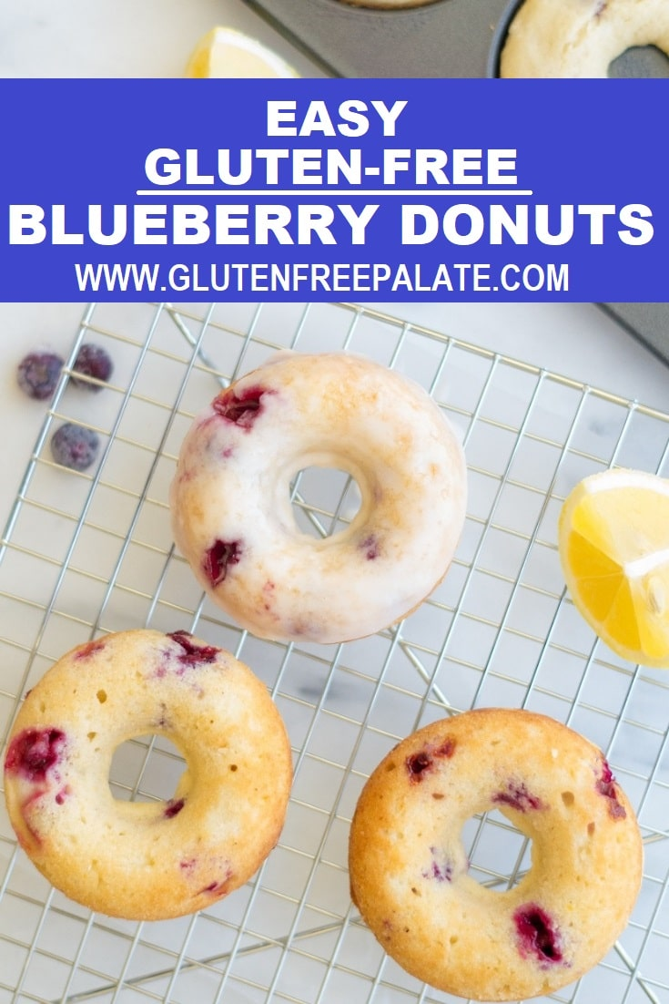 Gluten-Free Blueberry Donuts with a glaze on a wire rack