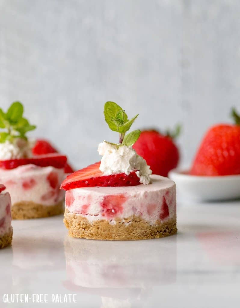 Super simple Gluten-Free No-Bake Mini Strawberry Cheesecakes that are creamy, refreshing, and perfect for anyone who loves a silky smooth cheesecake.
