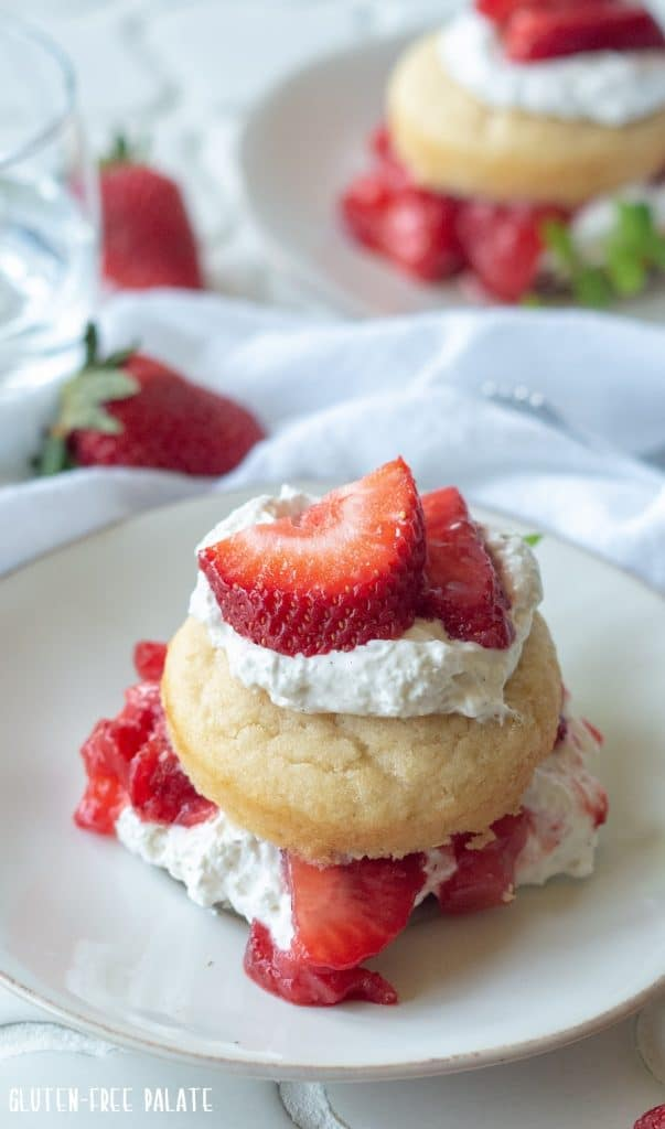 From scratch Gluten-Free Strawberry Shortcake using fresh whipped cream, juicy strawberries, and tender, homemade gluten-free shortcakes. This classic dessert is ready in less than an hour.