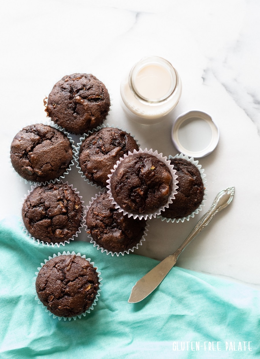 Grain-Free Chocolate Zucchini Muffins on a white background
