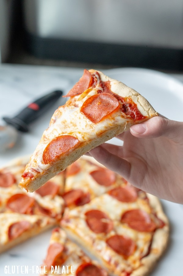 My go-to Gluten-Free Pizza Crust recipe is a simple staple for your Gluten-Free kitchen, and one of the best gluten-free pizza recipes out there.