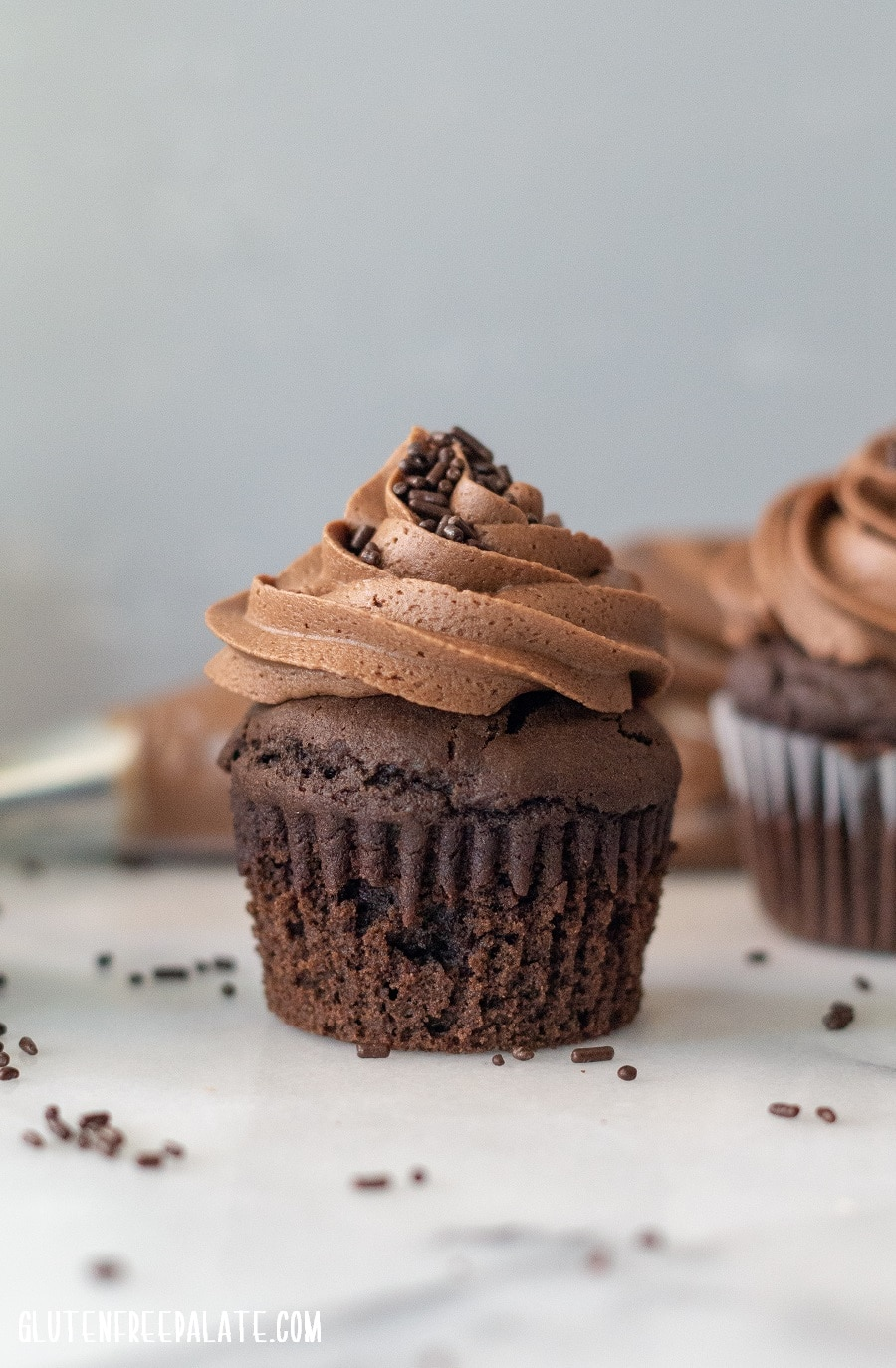 Gluten-Free Death By Chocolate Cupcakes that are rich, fudgy, and loaded with layers upon layers of chocolate.