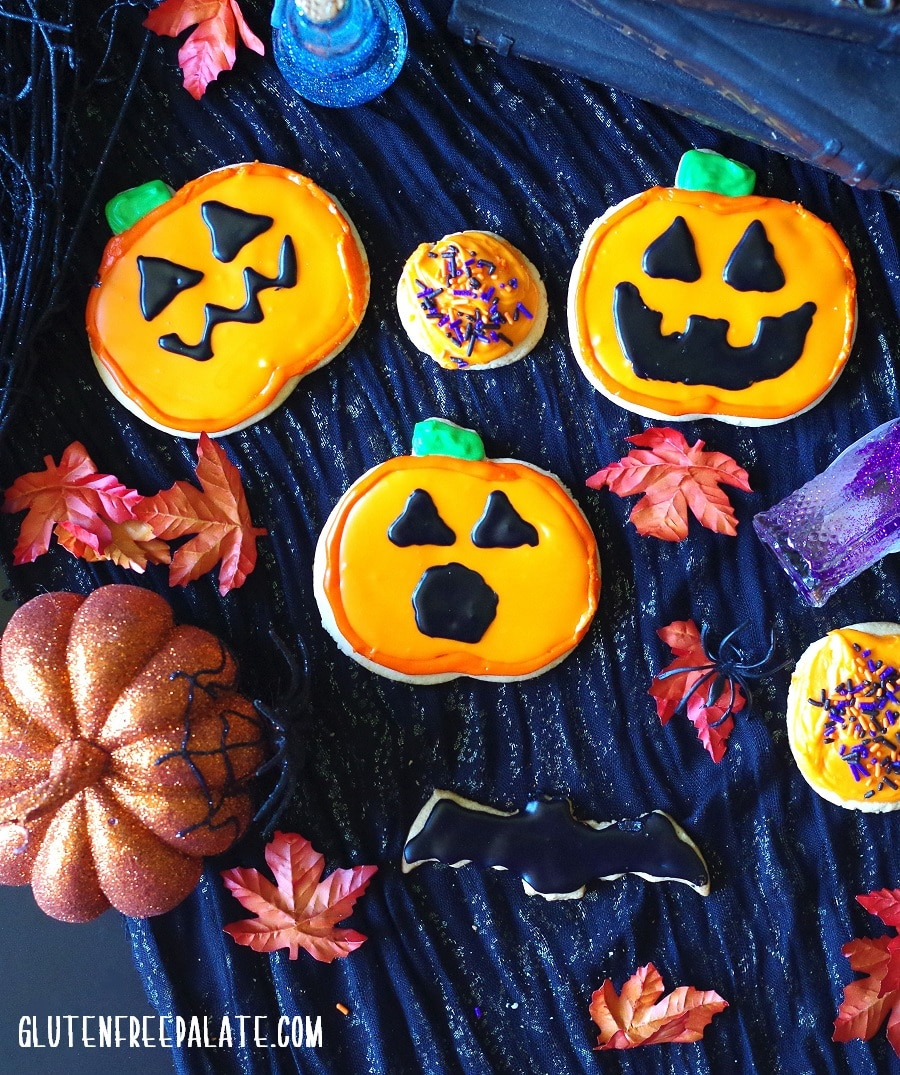 gluten-free sugar cookies decorated like pumpkins for Halloween