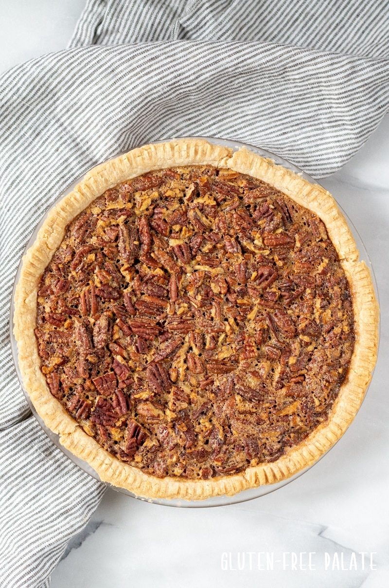 top down view of a whole gluten free pecan pie