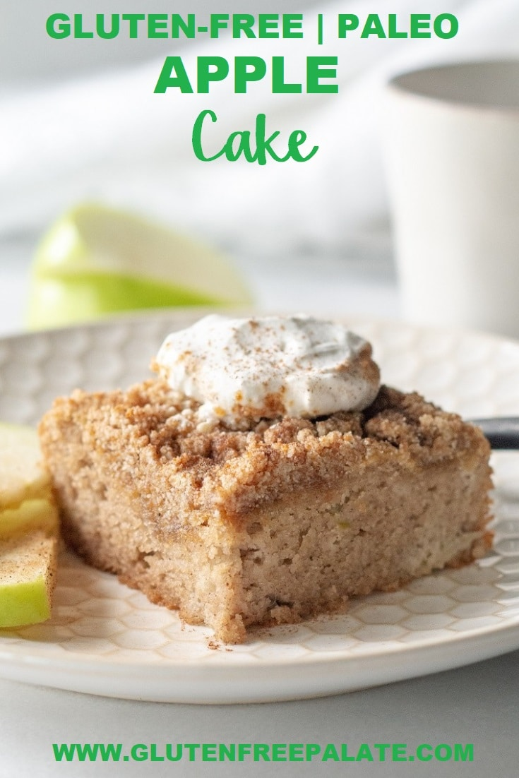 a slice of paleo apple cake with whipped cream on top, on a white plate with sliced apple, with the words gluten free paleo apple cake