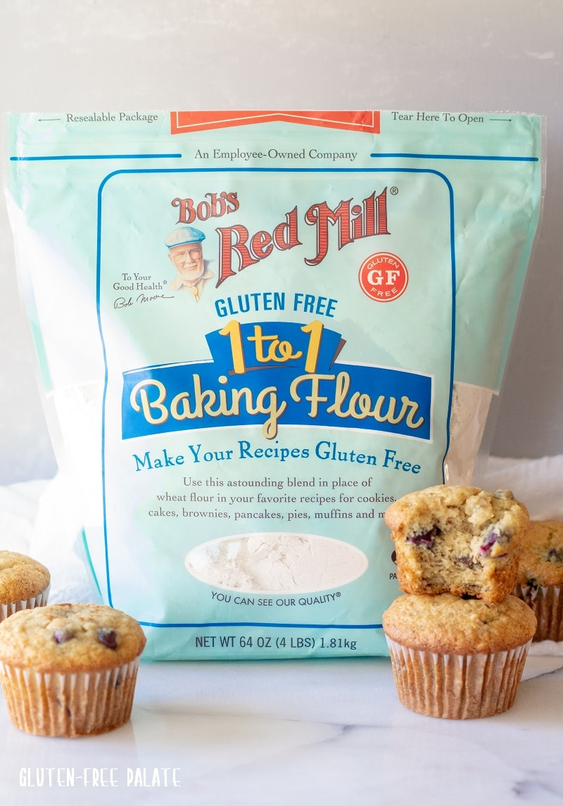 Gluten-free blueberry banana muffins in front of a bag of bob's read mill gluten-free flour.