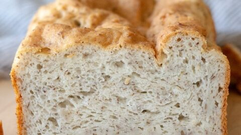 a close up of the inside of a loaf of gluten free bread on a cutting board