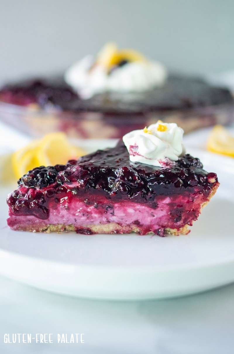 cream cheese pie with blackberries on a white plate