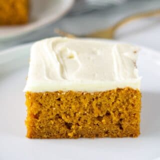 a slice of gluten free pumpkin cake on a white plate