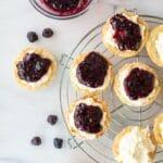 gluten free lemon blackberry tarts on a wire rack