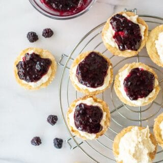 gluten free lemon blackberry tarts on a wire rack