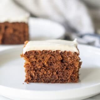 a slice of Gluten Free Gingerbread Cake on a white plate