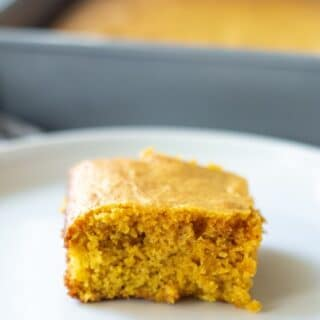 a slice of paleo cornbread on a white plate