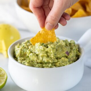 chip dipping into guacamole