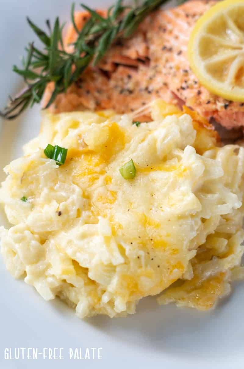 Cheesy Potatoes on a plate with salmon