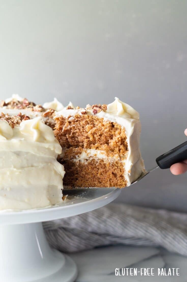 Cutting a slice of gluten free carrot cake