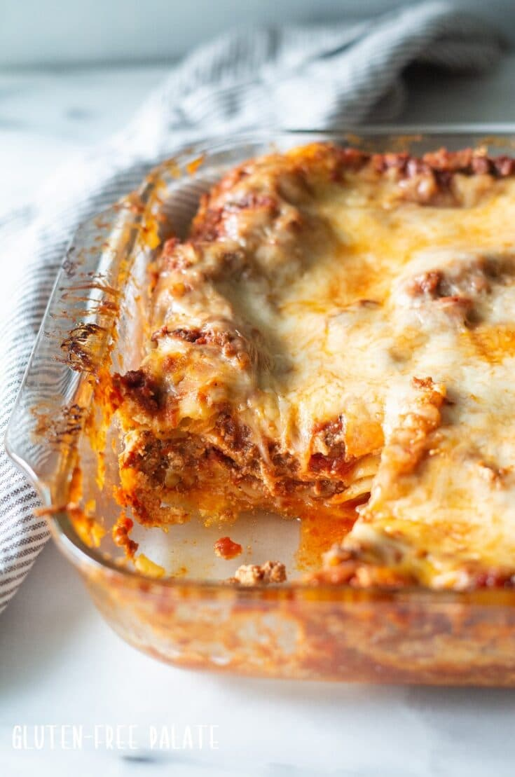 a side view of gluten free lasagna in a baking pan