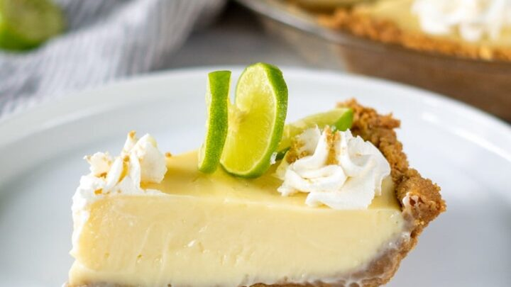 a slice of gluten free key lime pie on a white plate